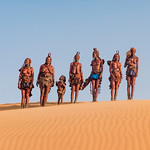 Himba people photoshoot on Sand Dunes near Serra Cafema Camp in Namibia