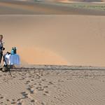 Photographer at Sand Dunes near Serra Cafema Camp in Namibia